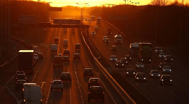 Traffic flows along the M56 motorway as the sun sets near Manchester, northern England February 15, 2016  REUTERS/Phil Noble