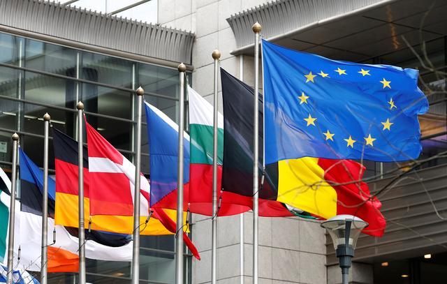 File Photo: European and national flags fly outside the European Parliament while European Commission President Jean-Claude Juncker presents a white paper on options for shoring up unity once Britain launches its withdrawal process, in Brussels, Belgium, March 1, 2017. REUTERS/Yves Herman