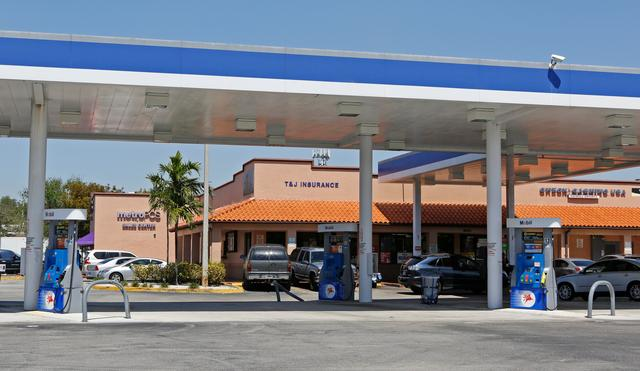 A gas station and shopping plaza are shown at 16650 NW 27 Ave. in Miami, Florida, U.S. March 15, 2017.    REUTERS/Joe Skipper