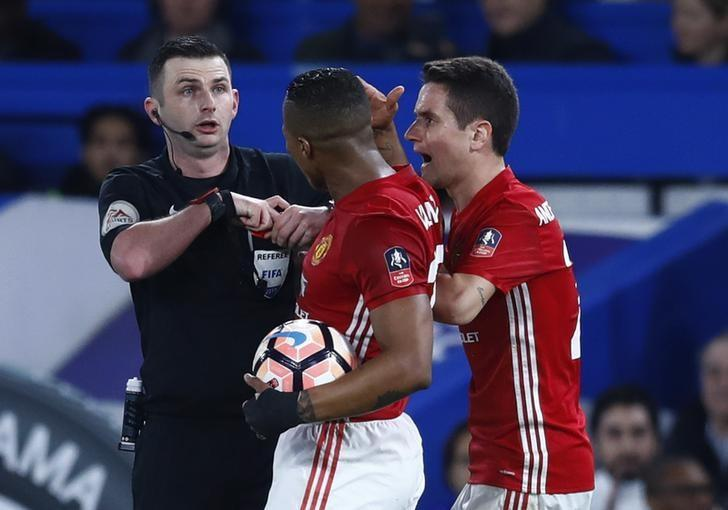 Britain Football Soccer - Chelsea v Manchester United - FA Cup Quarter Final - Stamford Bridge - 13/3/17 Manchester United's Ander Herrera is shown a red card by referee Michael Oliver Reuters / Eddie Keogh Livepic