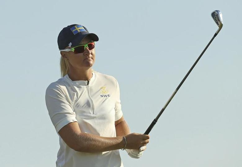 2016 Rio Olympics - Golf -  Women's Individual Stroke Play - Olympic Golf Course - Rio de Janeiro, Brazil - 17/08/2016.  Anna Nordqvist (SWE) of Sweden lines up her tee shot on the 16th hole during first round women's Olympic golf competition.  REUTERS/Andrew Boyers