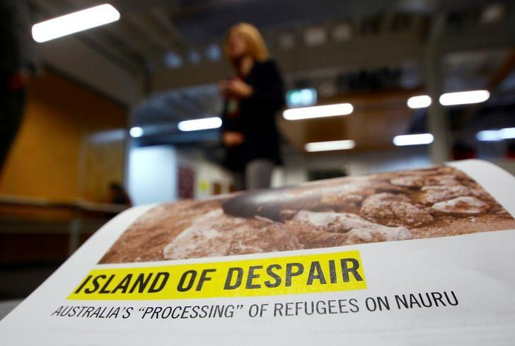 Anna Neistat, Senior Director for Research with Amnesty International, talks to journalists behind a copy of a report she co-authored titled 'Island of Despair - Australia's ''Processing'' of Refugees on Nauru' in Sydney, Australia, October 17, 2016 that concludes many of the 410 asylum seekers held on the tiny Pacific Island are being driven to attempt suicide to escape the prison-like conditions they face in indefinite detention on behalf of Australia.     REUTERS/David Gray/Files