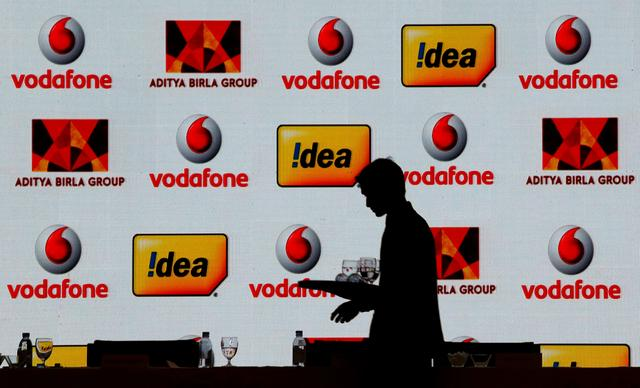 A hotel employee clears a table after Vodafone Group and Idea Cellular news conference in Mumbai, India March 20, 2017. REUTERS/Danish Siddiqui