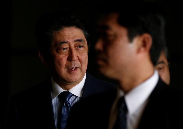 Japan's Prime Minister Shinzo Abe speaks to the media as he walks at his official residence in Tokyo, Japan March 16, 2017.   REUTERS/Toru Hanai/Files