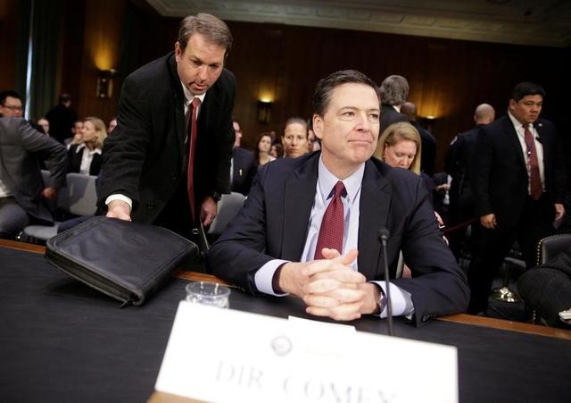 """FBI Director James Comey prepares to testify to the Senate Select Committee on Intelligence hearing on """"Russia's intelligence activities'' on Capitol Hill in Washington, U.S., January 10, 2017. REUTERS/Joshua Roberts"""