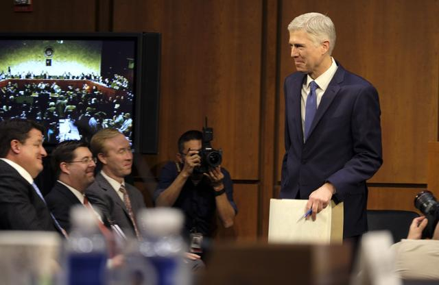 Supreme Court nominee judge Neil Gorsuch arrives to testify at his Senate Judiciary Committee confirmation hearing on Capitol Hill in Washington, U.S., March 20, 2017. REUTERS/James Lawler Duggan