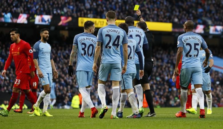 Britain Soccer Football - Manchester City v Liverpool - Premier League - Etihad Stadium - 19/3/17 Manchester City's Gael Clichy is shown a yellow card by referee Michael Oliver after conceding a penalty Action Images via Reuters / Jason Cairnduff Livepic