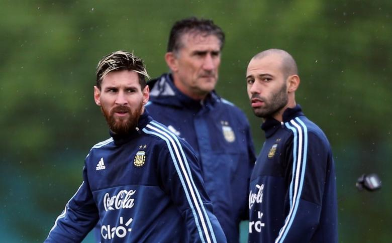Football Soccer - Argentina's national soccer team training - World Cup 2018 Qualifiers - Buenos Aires, Argentina - 13/11/16 - Argentina's players Lionel Messi and Javier Mascherano walk by head coach Edgardo Bauza. REUTERS/Marcos Brindicci