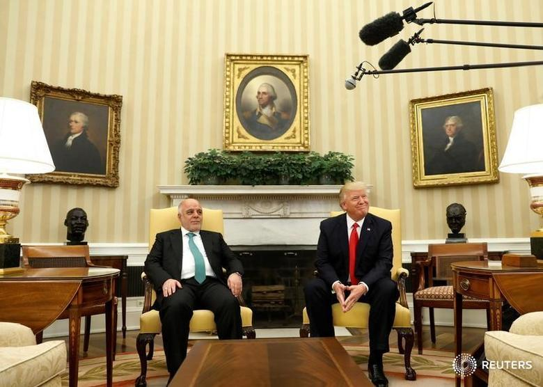 U.S. President Donald Trump meets with Iraqi Prime Minister Haider al-Abadi in the Oval Office at the White House in Washington, U.S., March 20, 2017. REUTERS/Kevin Lamarque - RTX31WQK