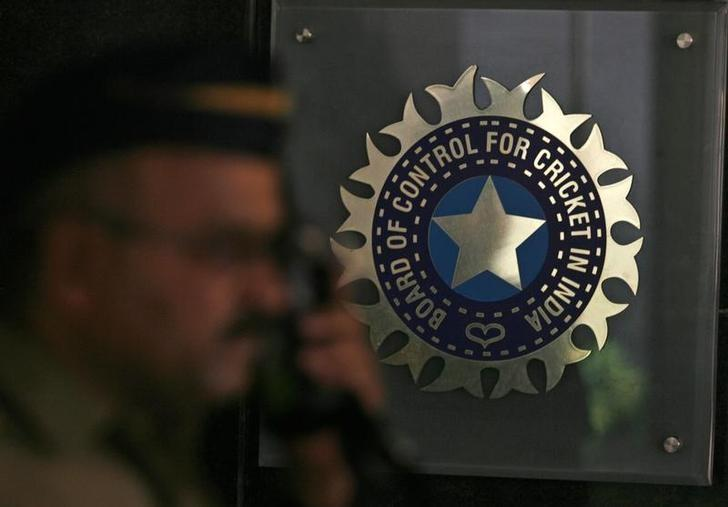 A policeman walks past a logo of the Board of Control for Cricket in India (BCCI) during a governing council meeting of the Indian Premier League (IPL) at BCCI headquarters in Mumbai April 26, 2010. REUTERS/Arko Datta/Files