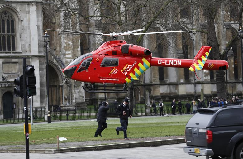 An air ambulance lands in Parliament Square during an incident on Westminster Bridge in London, Britain. REUTERS/Stefan Wermuth