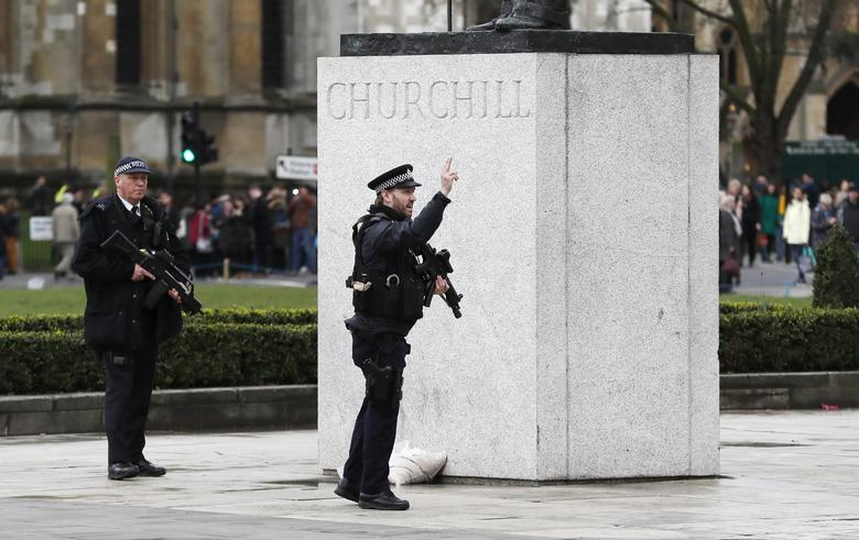 Armed police respond outside Parliament during an incident on Westminster Bridge in London, Britain. REUTERS/Stefan Wermuth