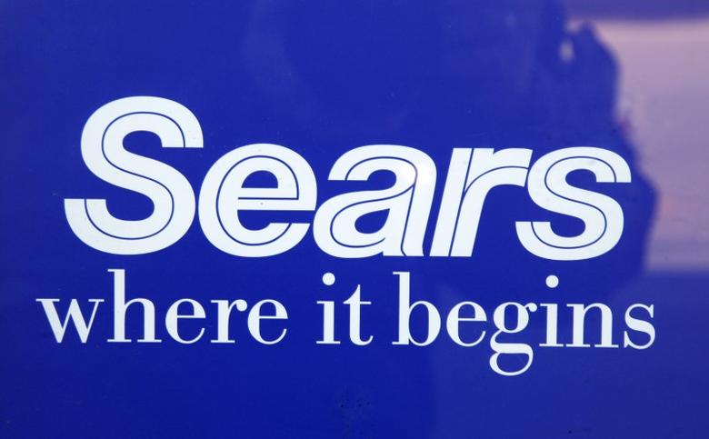 The sign on a door to a Sears store is seen in Denver February 26, 2009. REUTERS/Rick Wilking