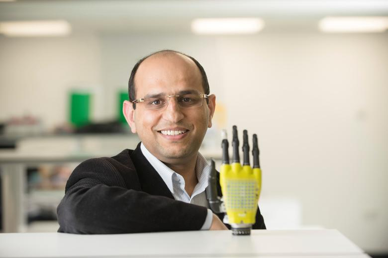 Ravinder Dahiya of the University of Glasgow's School of Engineering poses with the prosthetic hand developed by his team at Glasgow University, Scotland, Britain March 11, 2017. Photographic Unit University of Glasgow/Handout via REUTERS