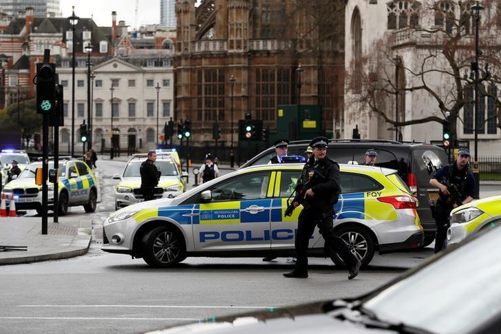 Armed police respond outside Parliament during an incident on Westminster Bridge in London, Britain March 22, 2017. REUTERS/Stefan Wermuth