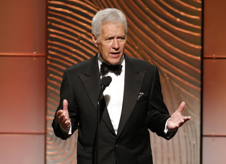 Jeopardy television game show host Alex Trebek speaks on stage during the 40th annual Daytime Emmy Awards in Beverly Hills, California June 16, 2013. REUTERS/Danny Moloshok/Files