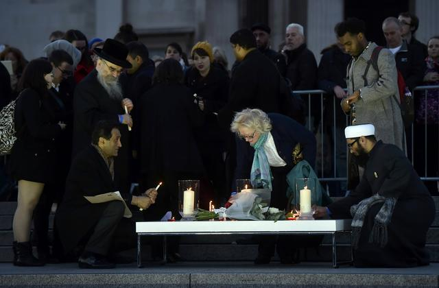 People light candles at a vigil in Trafalgar Square the day after an attack, in London, Britain March 23, 2017.     REUTERS/Hannah McKay