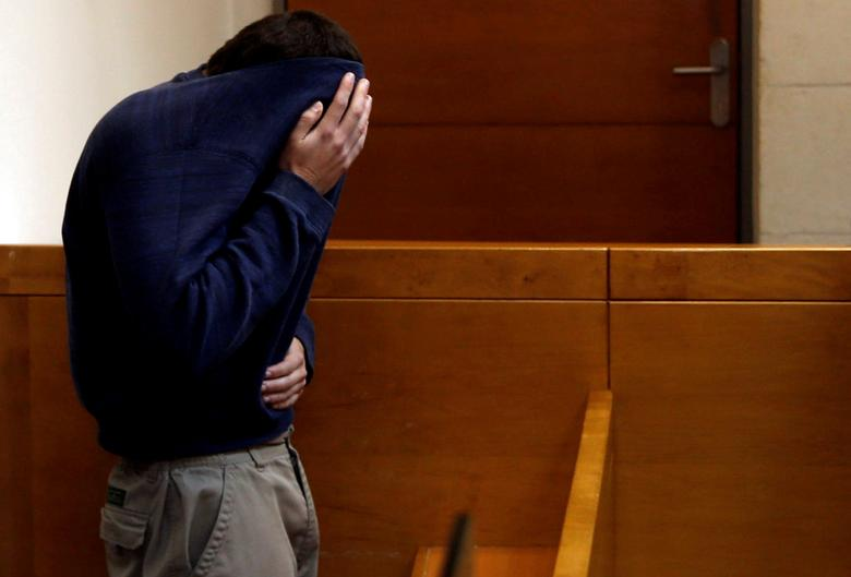 FILE PHOTO - An U.S.-Israeli teen who was arrested in Israel on suspicion of making bomb threats against Jewish community centres in the United States, Australia and New Zealand over the past three month, is seen before the start of a remand hearing at Magistrate's Court in Rishon Lezion, Israel on March 23, 2017. REUTERS/Baz Ratner/File Photo