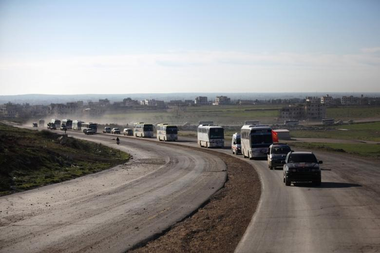 Buses carrying rebel fighters and their families who evacuated the besieged Waer district in the central Syrian city of Homs arrive on the southern outskirts of the Syrian city of al-Bab, Syria March 19, 2017. REUTERS/Khalil Ashawi