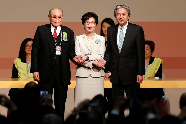 Candidates Woo Kwok-hing and John Tsang congratulate Carrie Lam (C) during the election for Hong Kong's next Chief Executive in Hong Kong, China March 26, 2017.   REUTERS/Bobby Yip