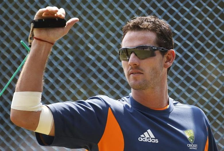 Australia's Shaun Tait performs a stretching exercise during a cricket practice session ahead of their ICC Cricket World Cup Group A match against Kenya on Sunday, in Bangalore March 11, 2011. REUTERS/Adnan Abidi/File Photo