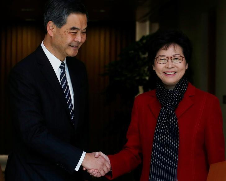 Newly elected Chief Executive Carrie Lam (R) meets current leader Leung Chun-ying in Hong Kong, China March 27, 2017.  REUTERS/Bobby Yip