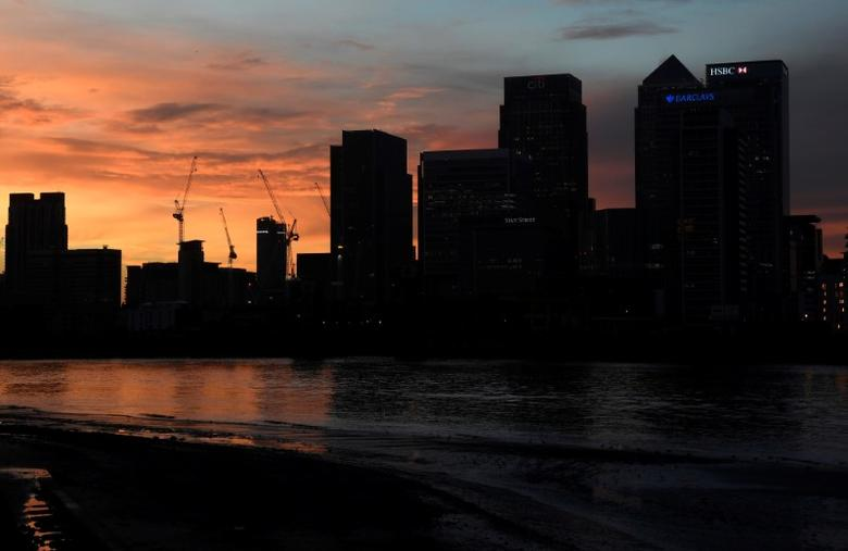 The Canary Wharf business district is seen at dusk in London, Britain December 11, 2016. REUTERS/Toby Melville