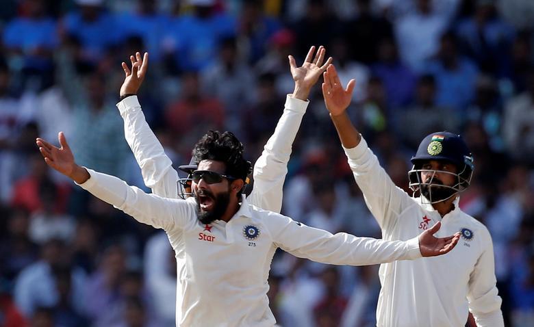 India v Australia - Third Test cricket match - Jharkhand State Cricket Association Stadium, Ranchi, India - 20/03/17 - India's Ravindra Jadeja (L) and Murali Vijay unsuccessfully appeal for the dismissal of Australia's Peter Handscomb. REUTERS/Adnan Abidi