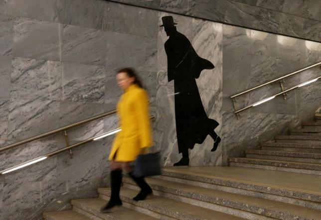 A passenger walks down the stairs at Dostoyevskaya metro station in Moscow, Russia, March 12, 2017. REUTERS/Grigory Dukor