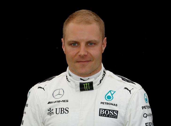 Formula One - F1 - Australian Grand Prix - Melbourne, Australia - 23/03/2017 Mercedes driver Valtteri Bottas of Finland poses during the driver portrait session at the first race of the year.     REUTERS/Brandon Malone