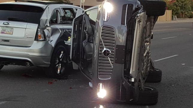 A self-driven Volvo SUV owned and operated by Uber flipped on its side after a collision in Tempe, Arizona.   Courtesy FRESCO NEWS/Mark Beach