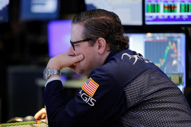 A trader looks at screens while working on the floor of the New York Stock Exchange.  REUTERS/Lucas Jackson
