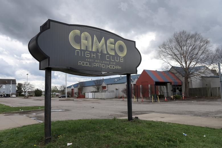 The parking lot of Cameo Nightlife club remains empty after police removed barrier tape from the scene of a mass shooting in Cincinnati, Ohio, U.S. March 26, 2017. REUTERS/Caleb Hughes