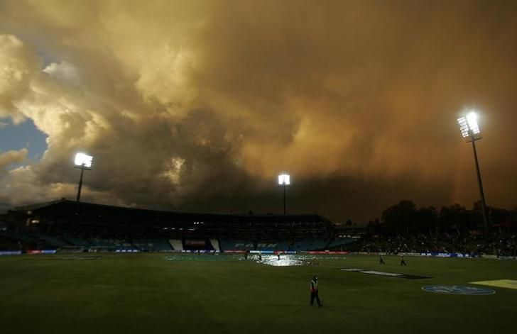 Clouds are seen as rain disrupts play during the 2009 Indian Premier League (IPL) T20 cricket tournament between the Chennai Super Kings and the Kings Punjab in Centurion, May 7, 2009. REUTERS/Siphiwe Sibeko/File Photo