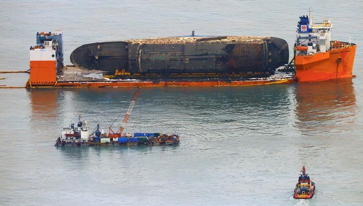 The sunken ferry Sewol sits on a semi-submersible ship during its salvage operations at the sea off Jindo, South Korea,  March 26, 2017.  Yonhap via REUTERS
