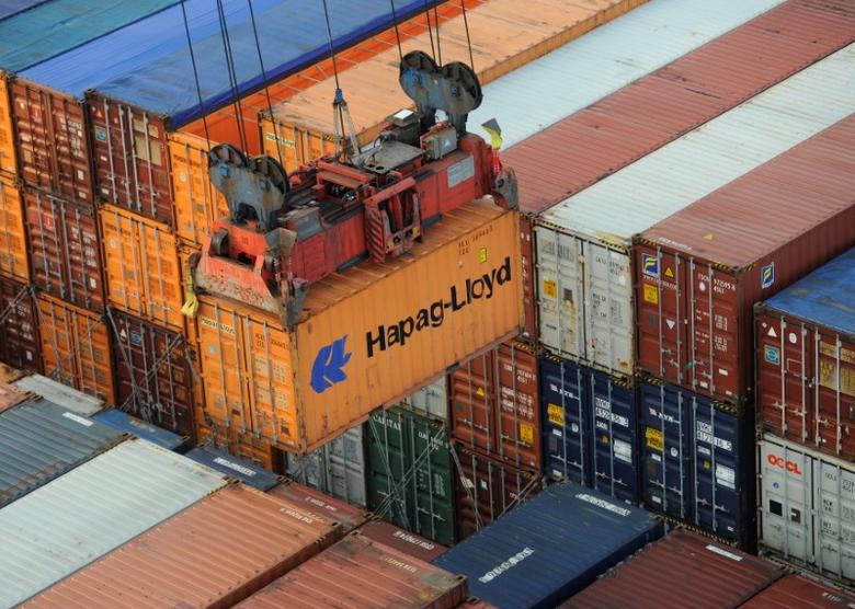 FILE PHOTO: A Hapag-Lloyd container is loaded from a container ship at the terminal Altenwerder in the harbour in Hamburg, Germany October 25, 2011. REUTERS/Fabian Bimmer/File Photo