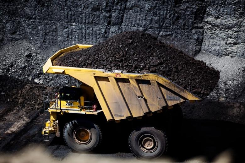 Haul trucks move coal as seen during a tour of Peabody Energy's North Antelope Rochelle coal mine near Gillette, Wyoming, U.S. June 1, 2016. The haul trucks operating at North Antelope Rochelle Mine hold 380 to 400 tons of material.  REUTERS/Kristina Barker