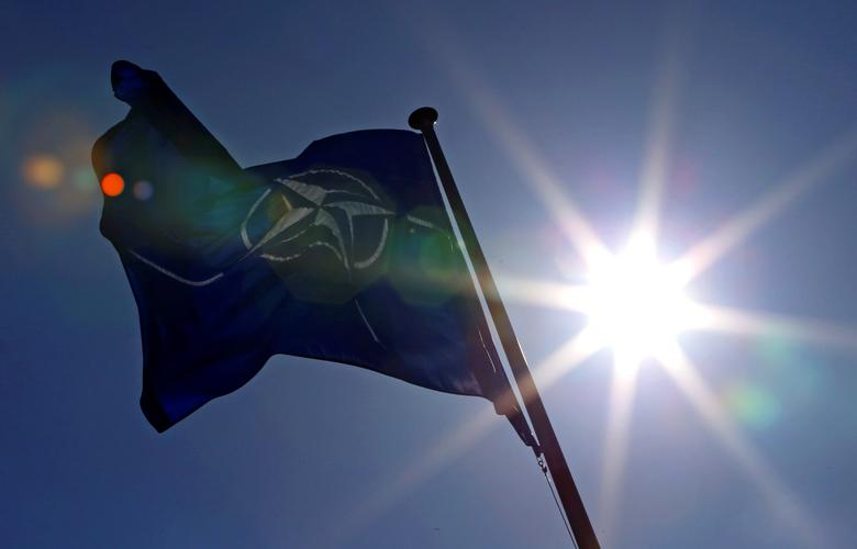 FILE PHOTO - A NATO flag flies at the Alliance's headquarters in Brussels, March 2, 2014.  REUTERS/Yves Herman/File Photo
