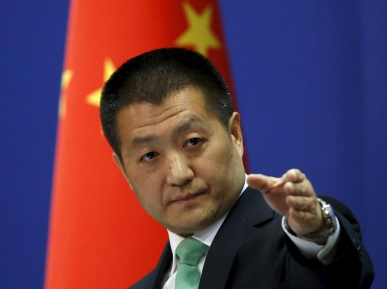 Chinese Foreign Ministry spokesman Lu Kang points out a reporter to receive a question at a regular news conference in Beijing, October 27, 2015. REUTERS/Kim Kyung-Hoon