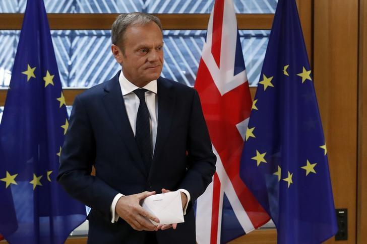 EU Council President Donald Tusk holds British Prime Minister Theresa May's Brexit letter which was delivered by Britain's permanent representative to the European Union Tim Barrow (not pictured) that gives notice of the UK's intention to leave the bloc under Article 50 of the EU's Lisbon Treaty in Brussels, Belgium, March 29, 2017.  REUTERS/Yves Herman