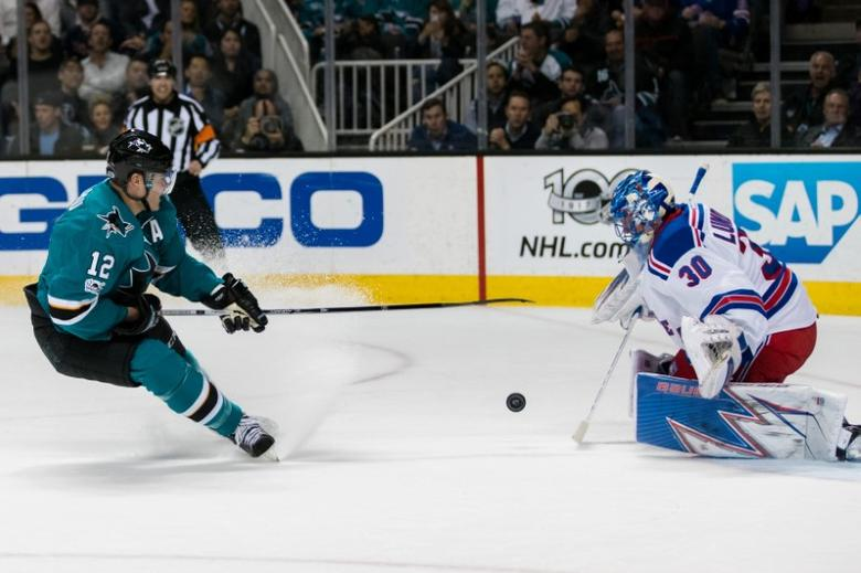 Mar 28, 2017; San Jose, CA, USA; San Jose Sharks left wing Patrick Marleau (12) shoots as New York Rangers goalie Henrik Lundqvist (30) defends in the first period at SAP Center at San Jose. John Hefti-USA TODAY Sports