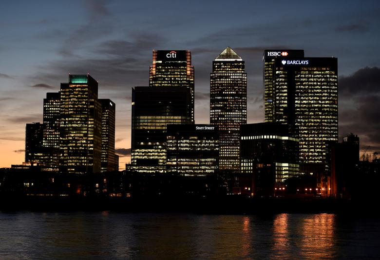 FILE PHOTO: The Canary Wharf financial district is seen at dusk in London, Britain November 7, 2014.  REUTERS/Toby Melville/File Photo