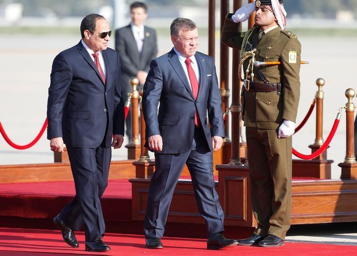 Jordan's King Abdullah II welcomes Egypt's President Abdel Fattah al-Sisi during a reception ceremony at the Queen Alia International Airport in Amman, Jordan March 28, 2017. REUTERS/Muhammad Hamed