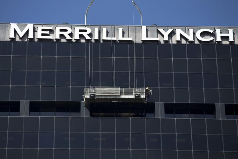 File photo: A worker washes windows high atop the Merrill Lynch building in downtown San Diego, California  September 1, 2015. REUTERS/Mike Blake