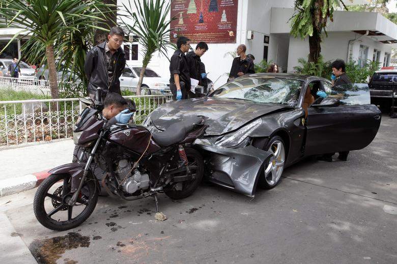 FILE PHOTO: Policemen examine a damaged Ferrari at the home of the late Red Bull founder Chaleo Yoovidhaya in Bangkok, Thailand September 3, 2012. REUTERS/Stringer/File Photo