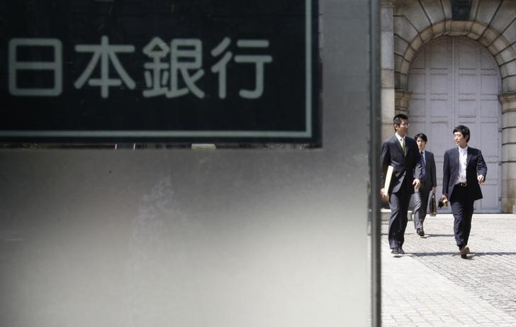 People walk out from the Bank of Japan headquarters in Tokyo May 7, 2012. REUTERS/Yuriko Nakao/Files