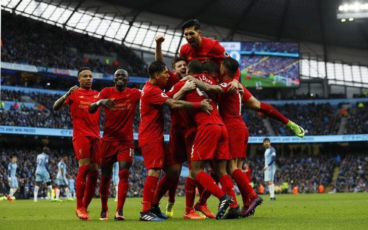 Britain Soccer Football - Manchester City v Liverpool - Premier League - Etihad Stadium - 19/3/17 Liverpool's James Milner celebrates scoring their first goal with team mates Action Images via Reuters / Jason Cairnduff/ Livepic/ Files