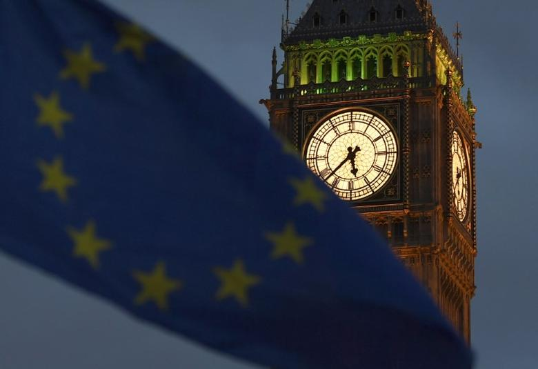 A European Union flag is waved in front of Big Ben and the Houses of Parliament in London, Britain, February 20, 2017. Picture taken February 20, 2017.  REUTERS/Toby Melville