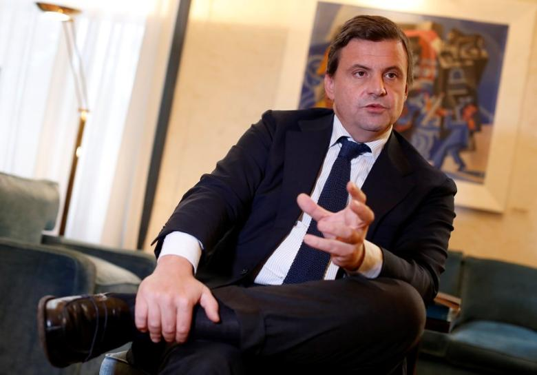 Italian Industry Minister Carlo Calenda gestures as he talks during an interview with Reuters in his office in Rome, Italy November 25, 2016. REUTERS/Tony Gentile