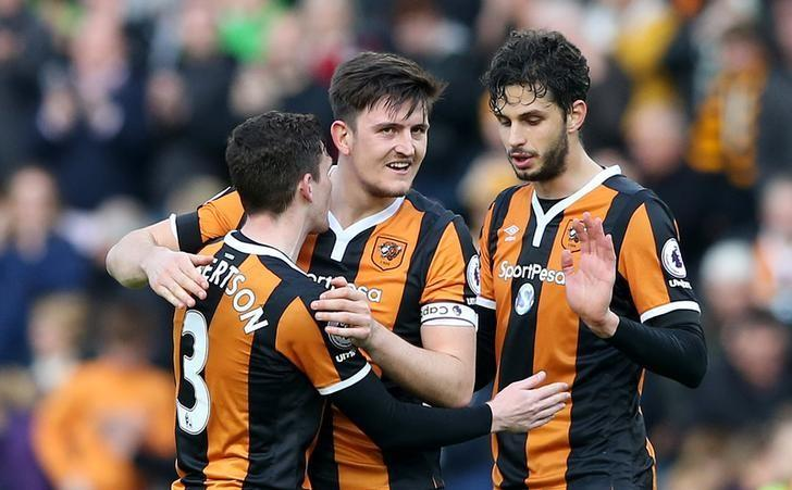 Britain Soccer Football - Hull City v West Ham United - Premier League - The Kingston Communications Stadium - 1/4/17 Hull City's Andrea Ranocchia, Harry Maguire and Andrew Robertson celebrate after the match Reuters / Scott Heppell Livepic